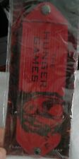 HUNGER GAME WRIST BAND  IN ORIGINAL PACKAGE UNUSED