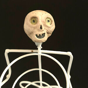 Skeleton Wire 7 1/2 Inch Candle Holder Clay Head