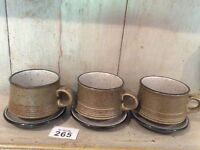 3 X Studio Pottery Cups And Saucers.