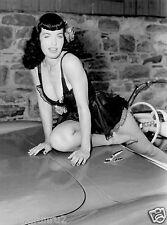 Bettie Page sitting on 1956 Corvette  5 x 7  Photograph