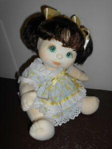 My child doll brunette piggie tails aqua blue eyes