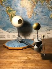 A VINTAGE PLANETARIUM ORRERY SHOWING EARTH AND MOON PHASES AROUND THE SUN 1965 2