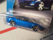 HOTWHEELS BLUE SATURN QUAD COUPE SCALE 1/64 - ON LONG CARD