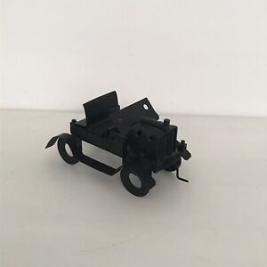 A SMALL SCRAP METAL SCULPTURE OF A MOTOR CAR