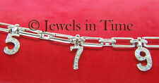 18k White Gold & Diamond Bracelet with Dangling Numbers