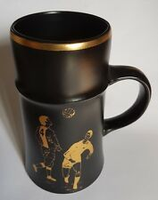 Royal Worcester Palissy Black Mug / Tankard with  Footballer Design in gilt