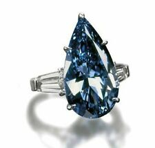 5.50 ct fancy vivid Blue Pear taper baguette three stone engagement ring white