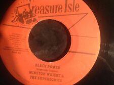 Treasure isle records . Black power / what more can I do . Winston wright