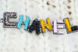 1 One Auth Chanel button 1 pieces 👍😘👍3 inch Emblem  long Multicolored