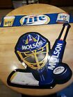 Molson hockey and Miller Lite tin beer sign