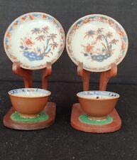 Two kangxi Imari tea bowl and saucers Chinese export