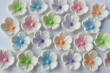 12 edible unicorn cake flowers. White multi colour cupcake flower decorations
