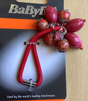 A BaByliss Bead Embellished Red Ponytail Band/ Hair Bobble