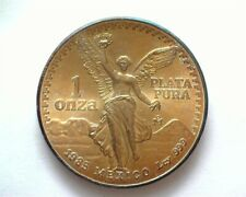 MEXICO 1985-MO SILVER ONZA PERFECT UNCIRCULATED IRIDESCENT TONING!