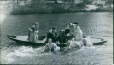 Michele Mercier and other women jumping to the water from a boat, from the movie