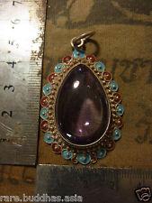 Beautiful Naga Eye stone set in a real Silver casing  , bright purple  beautiful