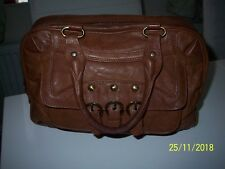 xude real leather tan bag.