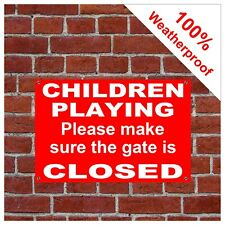 Children playing keep gate closed sign 9147