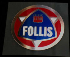 Follis Head Badge