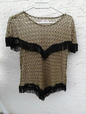 Golden lace women's shirt with black fringes