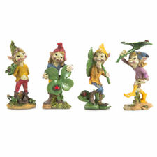 Darice® Miniature Fairy Garden Pixie Holding Shamrock - the 2nd from the left.