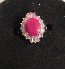 Natural Ruby and Sterling Silver Ring surrounded with clear topaz stones.