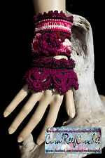 Crochet beaded bracelet cuff. Maroon, pinks and black. Trimmed with black lace.