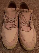 Woman I . E Nike Tennis Shoes.