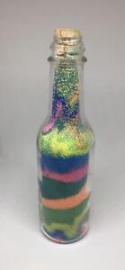 Bottle Of Multi Colored Sand And Mini Picture Frame