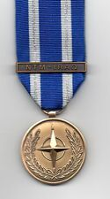 NATO MEDAL WITH CLASP:  NTM - IRAQ  FULL-SIZE CURRENT ISSUE  MEDAL
