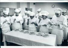 Press Photo Newbury College Students in Chef Outfits Taste Macaroni Cheese
