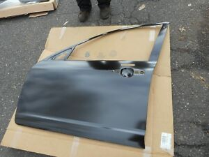 NEW 2006 - 2009 LINCOLN ZEPHYR AND MKZ DRIVERS SIDE FRONT DOOR SKIN ASBY NEW OEM