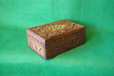 A HIGHLY DECORATED CARVED HINGED WOOD BOX  IN HARDWOOD TYPE E