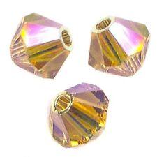 15 Perles Toupies 4mm en cristal Swarovski  LIGHT COLORADO TOPAZ AB2X