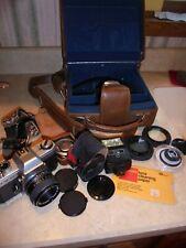 Yashika 35mm camera with multiple lenses, light meter, flash, camera bag