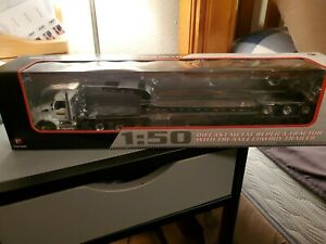 Kenworth new holland lowboy with Kobelco excavator still in boxes 1/50 scale