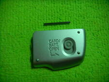 GENUINE CANON SX110 BATTERY DOOR SILVER PARTS FOR REPAIR