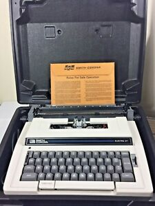 VINTAGE SMITH CORONA PORTABLE TYPEWRITER in CASE. Comes with Original Paperwork.
