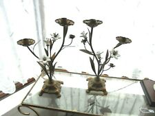 A PAIR OF VINTAGE GILT METAL BASE CANDLESTICKS WITH CERAMIC FLOWERS