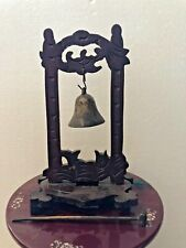 Small Brass Bell Mounted on Wooden Hanger