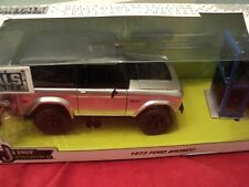 Jada 1973 Ford Bronco  NIB w/extra wheels  1/24 scale silver/black exterior