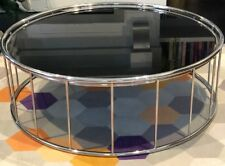 Minotti Replica Caulfield, Round black glass top coffee table with chrome base.