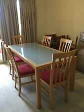 Glass top dining table, blond wood with 6 chairs