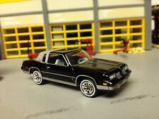 1/64 1984 Olds Cutlass Supreme in Black/Gray 1/2 Vinyl Top with a 307 Olds V8 /