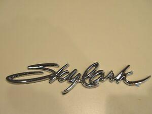 1992-98 Buick Skylark door emblem script  22569937 NEW
