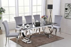 Black glass dining table and 6 grey velvet chairs