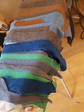 Good sized , mostly narrow remnants/scraps of wool fabric .Mixed colours