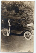Handsome, young man, automobile, American flags real photo postcard RPPC old car