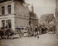 WW1 RFA Royal Field Artillery advancing through wrecked French town