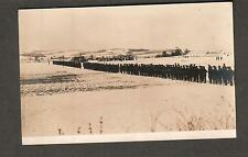 unmailed AZO RPPC photo post card WWI AEF ? line of soldiers in snow field camp